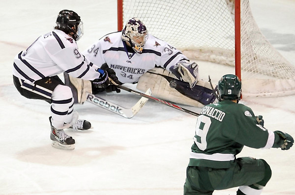 Pat Christman<br /> Minnesota State University goalie Cole Huggins makes a save on a shot y Bemidji State's Phillip Marinaccio during the second period Friday at the Verizon Wireless Center.
