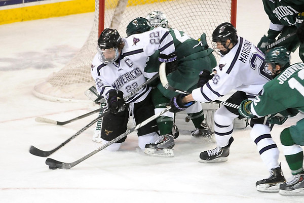 Pat Christman<br /> Minnesota State's Johnny McInnis is taken down in front of the Bemidji State net during the second period Friday at the Verizon Wireless Center.