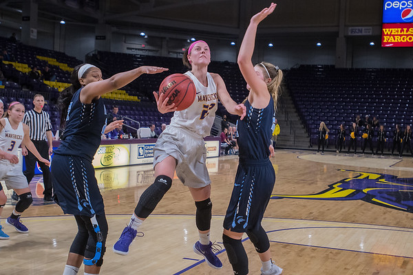 Claire Jordan (center of Minnesota State splits two Upper Iowa defenders in the second half of Friday's game played at Bresnan Arena. Photo by Jackson Forderer