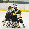 Mankato East/Loyola players celebrate after Bri Adams scored the game-winning goal in overtime against Windom in the Section 3A playoffs. Photo by Jackson Forderer