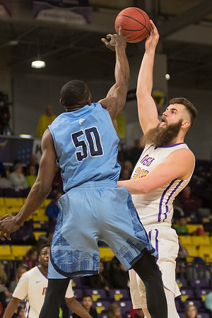 Isaac Kreuer of Minnesota State (right) has his shot tipped by Upper Iowa's Munachiso Okonkwo in the first half of Friday's game. Photo by Jackson Forderer