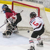 Mankato West's Sunshine Langworthy (5) scores the Scarlets third goal past Fairmont's goalie Emily O'Connor in the second period of Thursday's Section 3A playoff game. The Scarlets handed the Cardinals a 9-0 defeat. Photo by Jackson Forderer