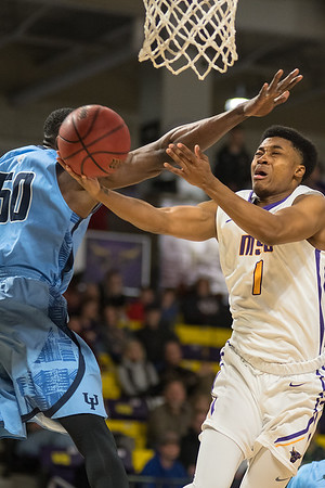 Minnesota State's Jamal Nixon (1) goes in for a layup while being guarded by Upper Iowa's Munachiso Okonkwo. Photo by Jackson Forderer