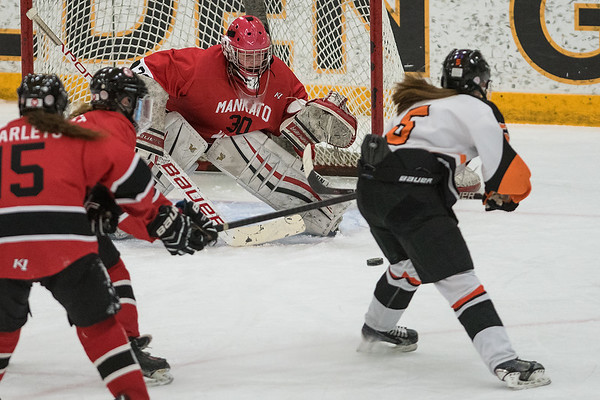 Mankato West goalie Sarah Olsen keeps her eye on a shot from Marshall's Sydney Mauch during Tuesday's Section 3A final game played in St. Peter. Olsen made 28 saves on 30 shots from the Tigers in the Scarlets overtime loss. Photo by Jackson Forderer