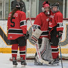 Mankato West's McKenna Krosch (14) and Hannah Wieland (15) console goalie Sarah Olsen after the Scarlets gave up their first goal to Marshall. The Scarlets answered back with a goal from Courtney Bloemke, but fell to Marshall 2-1 in overtime. Photo by Jackson Forderer