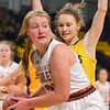 Mankato West's Claire Hemstock looks to pass the ball to a teammate during the Scarlets game against Mankato East in Dec. 2017. Photo by Casey Ek