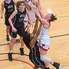 Bethany Lutheran's Abby Olson bumps into North Central's Alice Cato on her way to the basket in the second quarter of Wednesday's game. Photo by Jackson Forderer