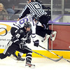 A linesman tries to leap out of the way as Providence's Kevin Rooney hits Minnesota State's Dylan Margonari during the first period Friday at the Verizon Wireless Center.