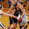 Mankato East's Claire Ziegler drives the lane during the first half Saturday at the East gym.