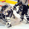 Minnesota State's Dylan Margonari hits the net during the first period Saturday at the Verizon Wireless Center.
