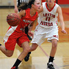 Mankato West's Lexi Schoper drives around Austin's Steph Justice during the first half Friday at the West gym.