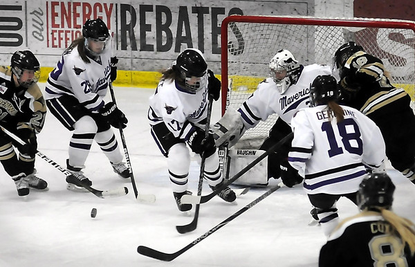 John Cross<br />  Mavericks (from left) Dani Scholzen, Elisabeth Hewett, Danielle Butters and Nicole Germaine defend against Lindenwood's Alyssa West (left) and Katie Erickson during first period action.