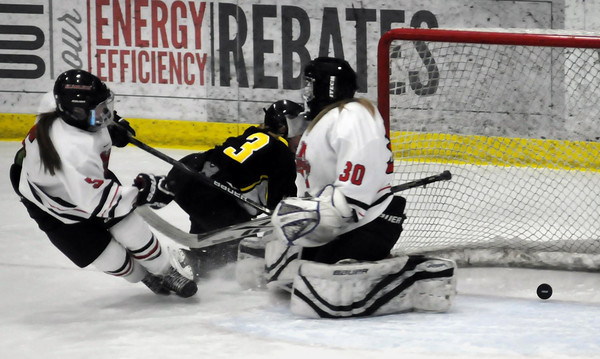 John Cross<br /> A shot by Hutchinson's Addie Rolling gets past Mankato West defender Lynn Braun and goalie Magie Cusey but just wide of the goal during first period action at All Seasons Arena on Thursday.