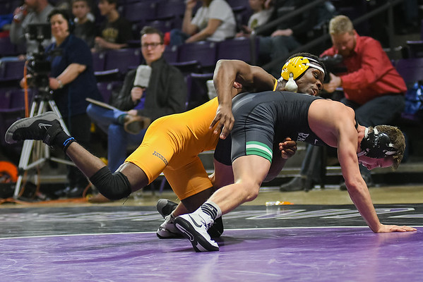 George Farmah of Minnesota State keeps control of his opponent Airk Furseth of UW-Parkside in the 133-pound match held at Bresnan Arena on Saturday. Farmah upset Furseth, who is ranked number three in NCAA Division II wrestling, by a score of 1-0. Photo by Jackson Forderer