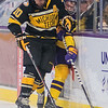Michigan Tech's Jake Jackson (left) checks Minnesota State's Andy Carroll into the boards in the first period of play on Friday. Carroll would later get his payback by scoring his first goal for the Mavericks on a 2-on-1 breakaway in the period. Photo by Jackson Forderer