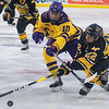 Minnesota State's Shane McMahan (10) and Michigan Tech's Tyler Rockwell (22) fight for a loose puck in the first moments of the first period of Friday night's game. Photo by Jackson Forderer