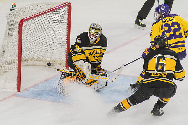 A shot by Minnesota State's Dallas Gerads (upper right) gets past Michigan Tech goalie Robbie Bedouin in the second period of Friday's game played at the Verizon Center. The Mavericks won the game to remain undefeated at home this season. Photo by Jackson Forderer