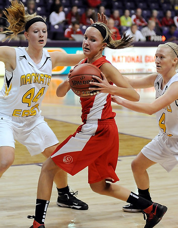 West's Lexi Schoper is sandwiched between East's defenders  Claire Zielger (44) and Marta Anderson.