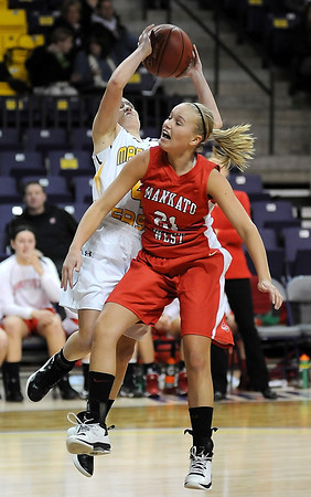 West's Malorie Veroeven and East's Marta Anderson battle for a rebound.