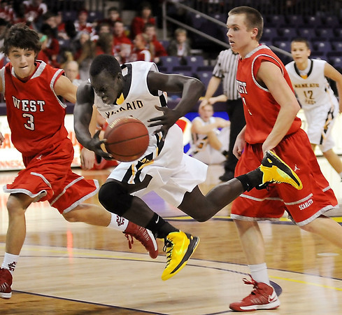 West's Tyler Stoffel (3) and Jake Dale and East's Mattu Chuol chase down a loose ball.