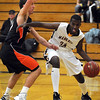 Mankato East's Yasin Omar tries to get past Marshall's Austin Saugstad during the first half Saturday at the East gym.