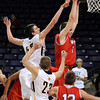 West's Jake Dale has the position over East's Matt Bornholdt as the go for a rebound.