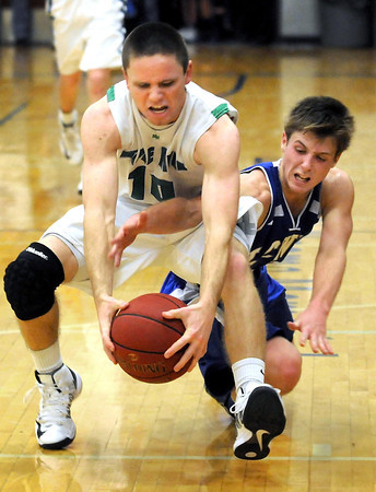 Maple River's Michael Lewis beats Lake Crystal Wellcome Memorial's Bryson Yackel to a loose ball during the second half of their game Friday in Lake Crystal.