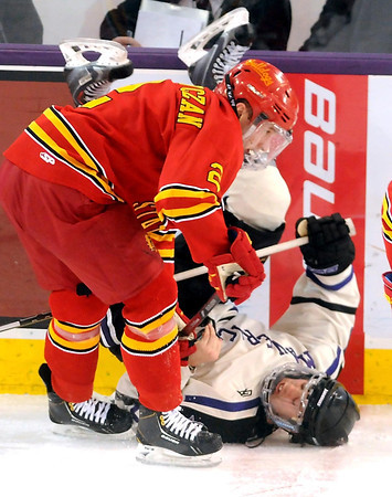 Pat Christman<br /> Minnesota State's Matt Leitner gets knocked down by Ferris State's Scott Czarnowczan during the first period Saturday at the Verizon Wireless Center.