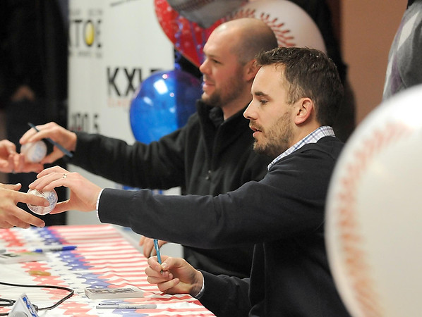 Pat Christman<br /> Minnesota Twins relief pitchers Brian Duensing (foreground) and Ryan Pressly sign baseball for fans during the Twins Winter Caravan stop in Mankato Thursday.
