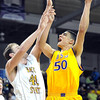 Pat Christman<br /> Minnesota State's Assem Marei shoots over Wayne State's Patrick Kurth during the first half Saturday at Bresnan Arena.