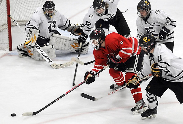 Pat Christman<br /> Mankato West's Galt Goettl is surrounded by Mankato East/Loyola defenders as he tries to get a shot off during the first period Tuesday at All Seasons Arena.