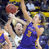 Pat Christman<br /> Wayne State's Ellen Hansen and Minnesota State's Jamie Bresnahan (33) battle for a rebound during the second half Saturday at Bresnan Arena.