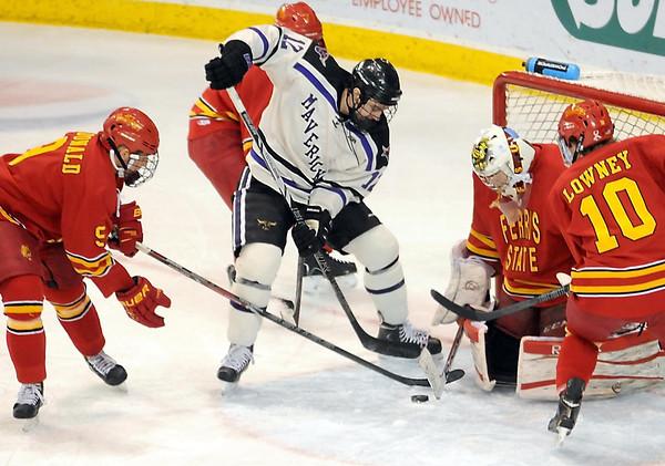 Pat Christman<br /> Minnesota State's Jean-Paul Lafontaine tries to put the puck past Ferris State goalie C.J. Motte during the first period Saturday at the Verizon Wireless Center.