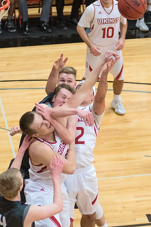 Men's basketball players from Bethany Lutheran and North Central clash as they vied for a rebound in the second half of Wednesday's game played at Bethany. The Vikings maintained their halftime lead and won 77-60. Photo by Jackson Forderer