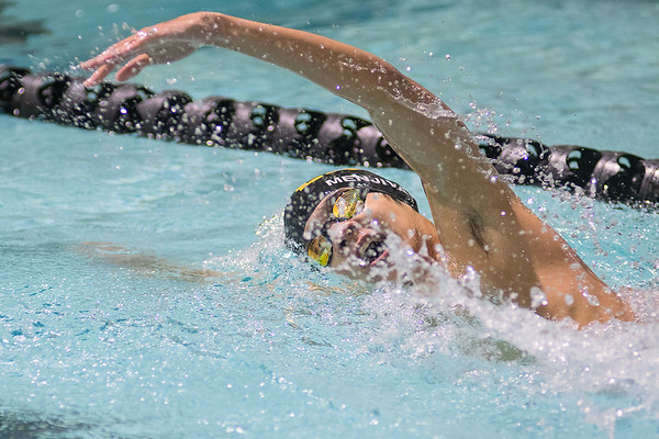 John Menjivar swims in the 200 meter individual freestyle event on Thursday. Menjivar took first in the race with a time of 1:55.85. Photo by Jackson Forderer