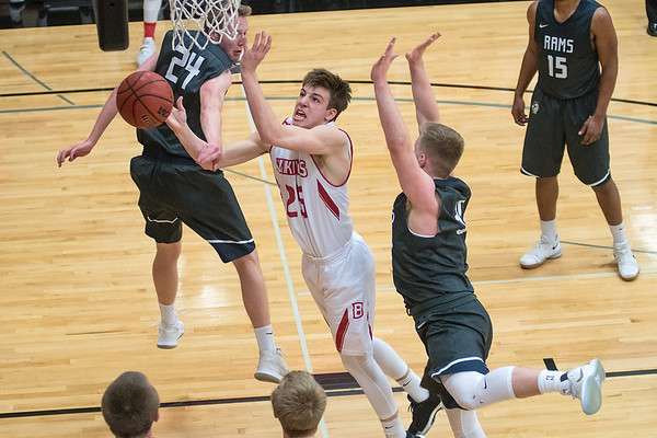 Bethany Lutheran's Jared Milinkovich loses control of the ball after being fouled by North Central's Jared High (24) on the way to the basket during Wednesday's UMAC conference game. The Vikings prevailed 77-60. Photo by Jackson Forderer