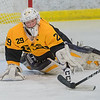 Mankato East/Loyola goalie Jack Cusey poke checks the puck away from a New Prague player at the last second during Tuesday's non-conference game played at All Seasons Arena. The Cougars won the game 3-1. Photo by Jackson Forderer