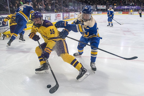 Minnesota State's Reggie Lutz take control of the puck in the corner while being defended by Lake Superior State's Gage Torrel in the second period of Friday's WCHA game played at the Verizon Center. Photo by Jackson Forderer