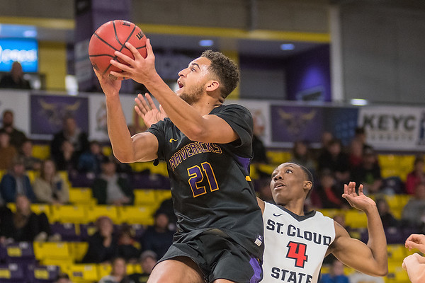 Minnesota State's Cameron Kirksey (21) jumps past St. Cloud State's Trevor Marshall (4) while on a fast break during Saturday's NSIC conference matchup. Photo by Jackson Forderer