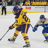 Nicholas Rivera of Minnesota State switches to his back hand at the last second in front of Lake Superior State goalie Nick Kossoff before scoring the first goal of the game shorthanded. Photo by Jackson Forderer
