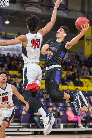 Minnesota State's Quincy Anderson goes up for a shot while being defended by St. Cloud State's Sean Smith in the first half of Saturday's game played at Bresnan Arena. The Mavericks lost in overtime to the Huskies. Photo by Jackson Forderer