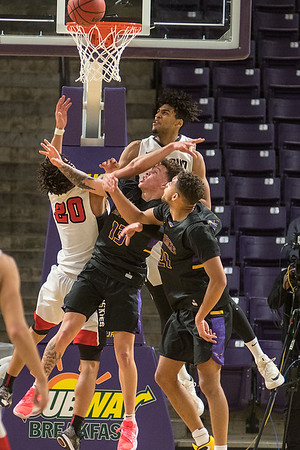 Minnesota State players Trey Baumgardner and Cameron Kirksey fight for a rebound against St. Cloud State's Gage Davis and Sean Smith. Photo by Jackson Forderer