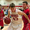 NRHEG's Tyler Raimann drives the baseline past Stephen Kletscher of St. Croix Lutheran in a semifinal game of the Pepsi Holiday Tournament held at Bethany Lutheran College. Photo by Jackson Forderer