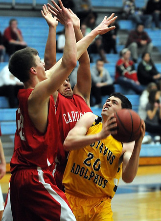Gustavus Adolphus College's Ben Biewen faces a pair of St. Mary's defenders as he tries to take a shot during the first half Wednesday in ST. Peter.