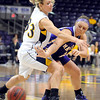 Minnesota State's Karlee Gengenbacher passes around Augustana's Faith Tinklenberg during the second half Saturday at Bresnan Arena.