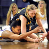 Minnesota State's Jameila Hudnel (left) and Wayne State's Ellen Hansen scramble for a loose ball during the second half Friday at Bresnan Arena.