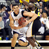 Minnesota State's Assem Marei tries to get around Wayne State's Adol Aluong during the first half Friday at Bresnan Arena.