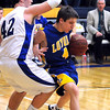 Mankato Loyola's Ryan Van Blarcom (4) slips around Nicollet's Matt Christenson during the second half Thursday at the Fitzgerald gym.