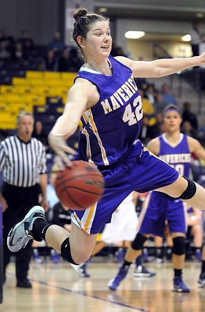 Minnesota State's Ali Wilkinson leaps as she tries to save a ball from going out of bounds during the second half Saturday at Bresnan Arena.