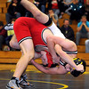 Mankato East's Keanu Rodriguez ends up on top of Mankato West's Sam Schwartz as they fall to the mat during their 152 pound match Tuesday at the East gym.